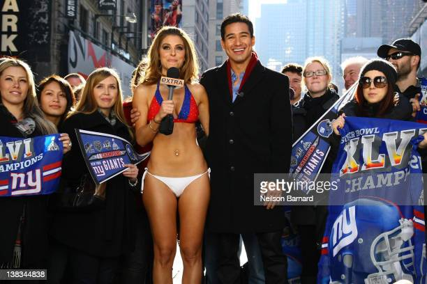 'Extra' hosts Mario Lopez and Maria Menounos an avid New England Patriots fan makes good on her Super Bowl bet with her fellow show correspondent...