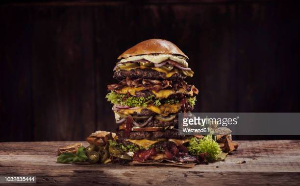 extra large cheese bacon burger - hamburger stock pictures, royalty-free photos & images