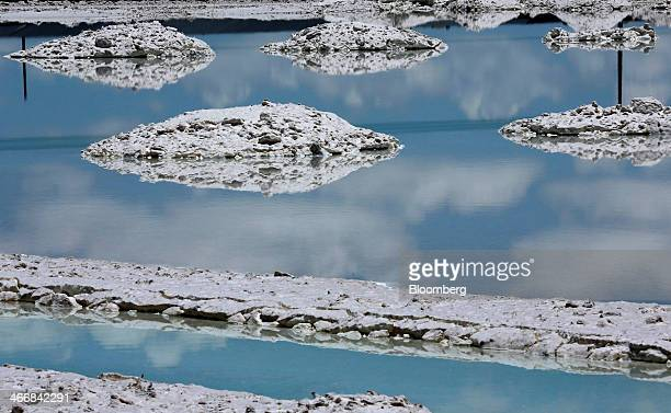Extracted salt sits in piles in an evaporation pool where lithium bicarbonate is isolated from salt brine during the process of lithium production at...