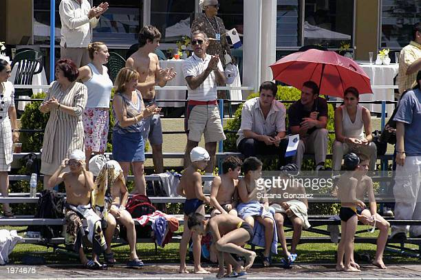 Extras acting as swimmers sit on the side of a swimming pool while filming a scene of Man On Fire at a sports club May 5 2003 in Mexico City Mexico