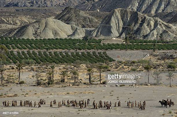 Extras and actors of television series 'Game of Thrones' walk in a scenery of the southern Spanish village of Pechina Almeria province where part of...
