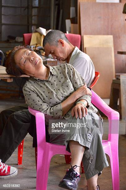 Extras catching some sleep on the Hong Kong film set of Rigor Mortis a horror film about vampires The film is Juno Mak's directorial debut and is...