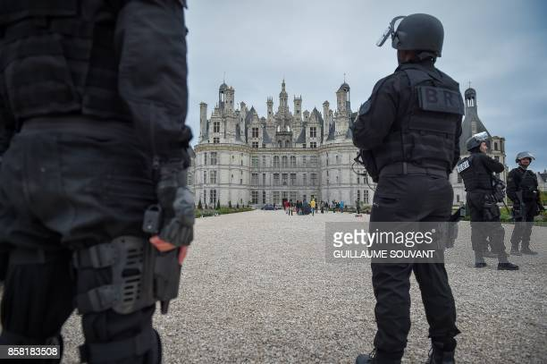 Extras dressed as French BRI police stand outside the Chateau of Chambord during the shooting of the Indian action film 'Junga' on October 5 2017 The...