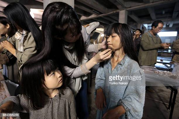 Extras for director Shinji Higuchi's film 'Attack on Titan' put makeup before filming on June 9 2014 in Takahagi Japan