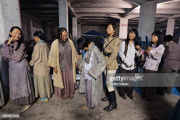 Extras in costumes lineup before filming for director Shinji Higuchi's film 'Attack on Titan' on June 9 2014 in Takahagi Japan