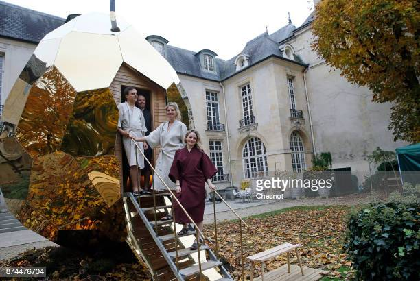 Extras pose in front of the public sauna art installation entitled 'Solar Egg' by Swedish artists Mats Bigert and Lars Bergstrom in the garden of the...