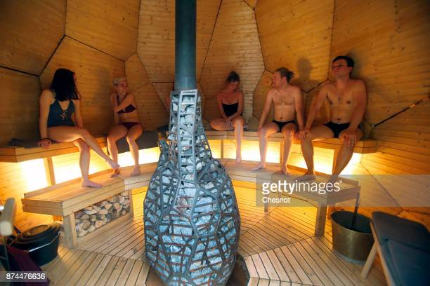 Extras pose inside the public sauna art installation entitled Solar Egg by Swedish artists Mats Bigert and Lars Bergstrom in the garden of the...