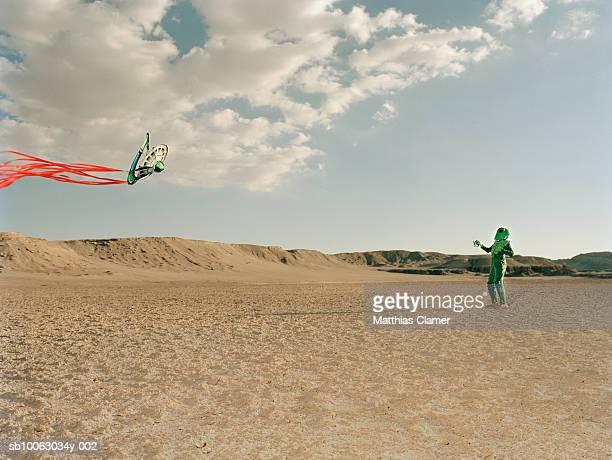 Extraterrestrial flying kite in desert