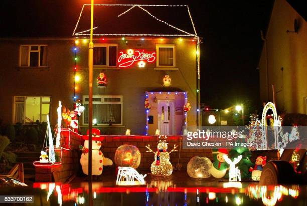 Extravagant Christmas lights decorate a house in Peebles in the Scottish Borders