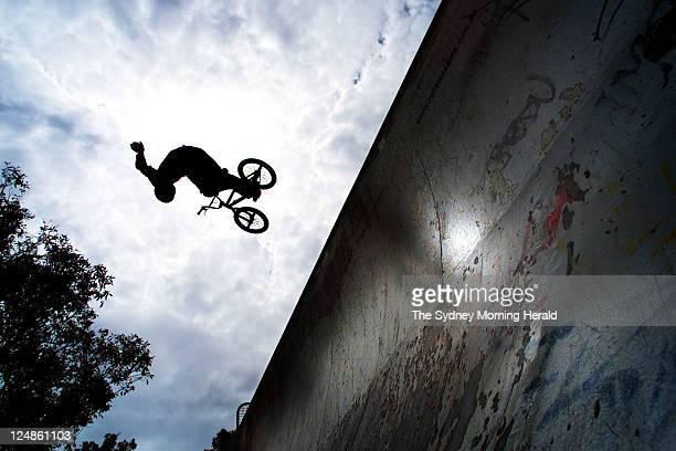 Extreme BMX rider Matt Fairbairn practising his moves at the Mona Vale half pipe on Thursday 28 November 2002.