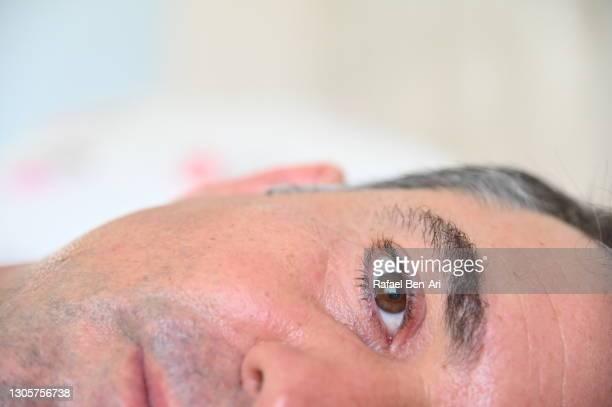 extreme close up of a man waking up - rafael ben ari imagens e fotografias de stock