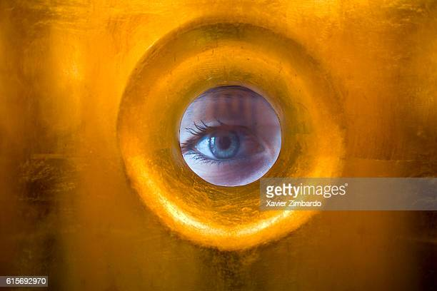 Extreme close up of a woman eye looking through a hole in a wall on December 6 2008 in the toilet of ArteFAQ Cafe at Moscow Russia Videos in these WC...