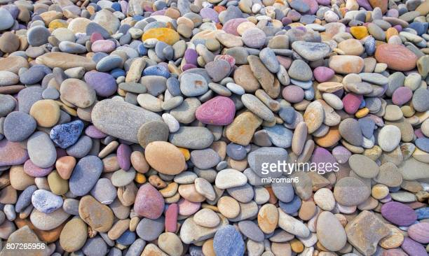 extreme close up of colourful pebbles - pebble stock photos and pictures