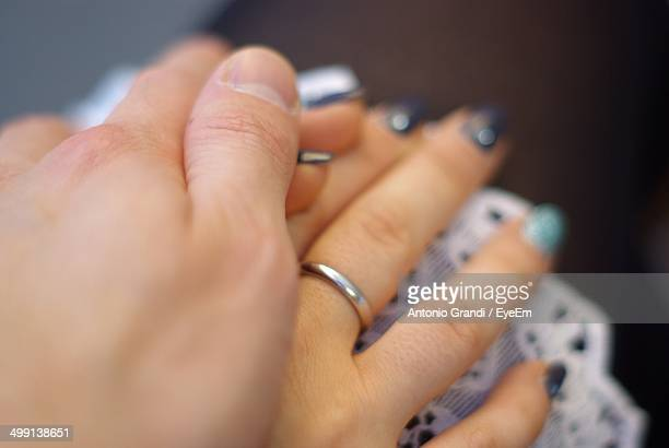 Extreme close up of couple holding hands