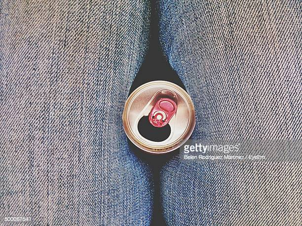 extreme close up of denim jeans with tin can - human limb stock pictures, royalty-free photos & images