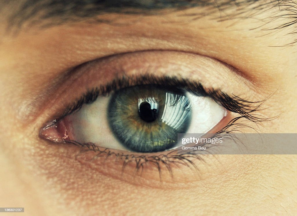 Extreme close up of Green eyes : Stock Photo