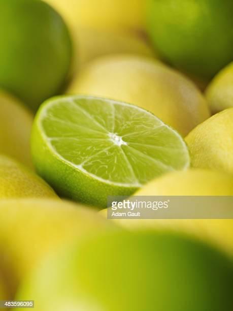 Extreme close up of sliced lime among lemons