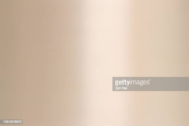 extreme close up of stainless steel -metal with reflected light - cream colored stock pictures, royalty-free photos & images