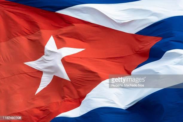 extreme close up of the cuban flag waving - bandera cubana fotografías e imágenes de stock