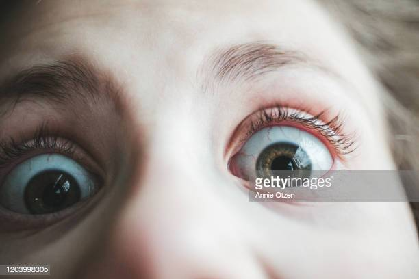extreme close up of wide open eyes - extreme close up stock pictures, royalty-free photos & images