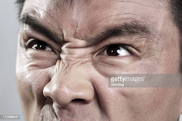 extreme close up on angry mans face - furioso fotografías e imágenes de stock