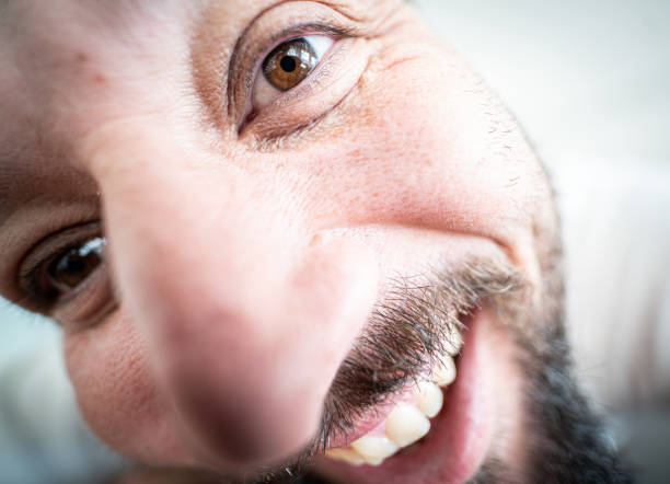 Extreme close up portrait of quirky laughing man