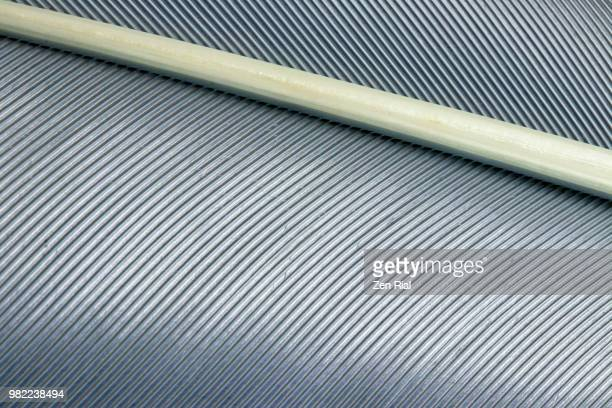extreme close-up of a gray bird feather - feather stock pictures, royalty-free photos & images