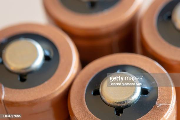 Extreme close-up of a group of AA batteries. Each year consumers dispose of billions of batteries which, if not recycled, can damage the environment.
