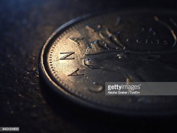 extreme close-up of canadian quarter on floor - canadian currency stock pictures, royalty-free photos & images