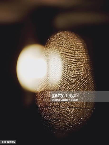 Extreme Close-Up Of Fingerprint On Glass