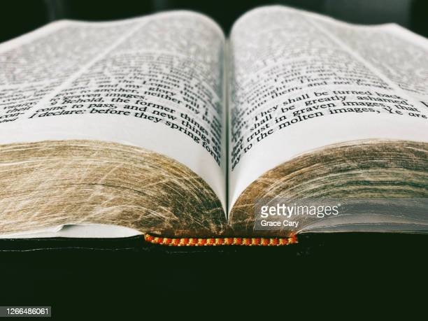 extreme close-up of open bible - old testament stock pictures, royalty-free photos & images