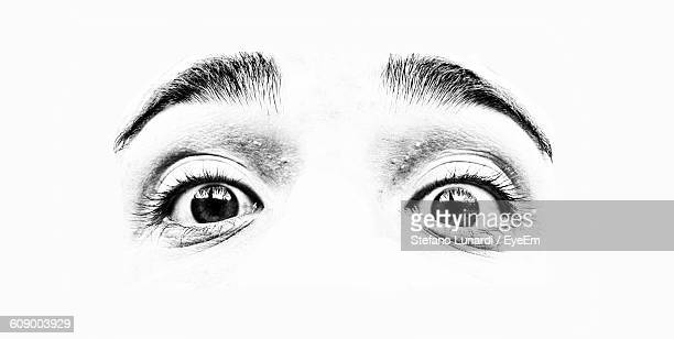 Extreme Close-Up Of Person Eye Against White Background