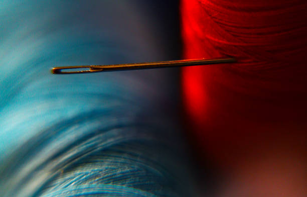 Extreme Close-Up Of Spool With Needle