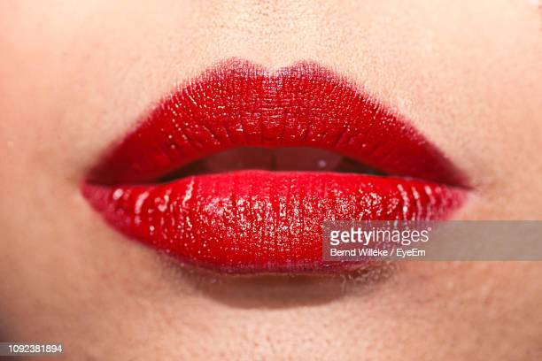 extreme close-up of woman lips - red lipstick stock photos and pictures