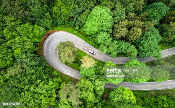 extreme curve ,country road - turning stock pictures, royalty-free photos & images