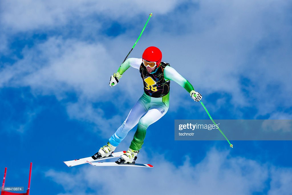 Extreme jump at downhill race : Stock Photo