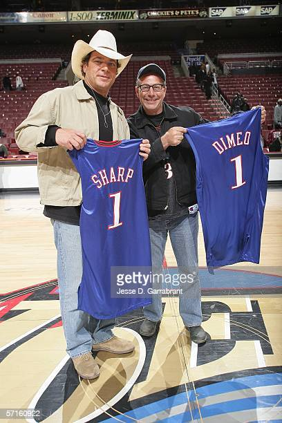 Extreme Makeover: Home Edition Design Team members Paul Dimeo and Preston Sharp receive jersey's during halftime at the game between the Philadelphia...