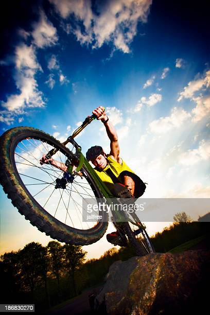 Extreme mountain biking jumping off a rock