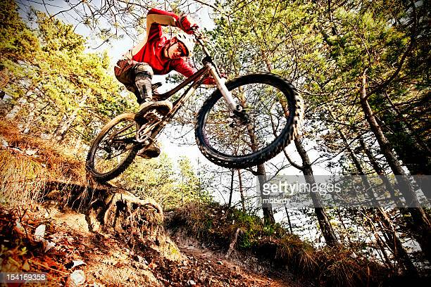 Extreme mountainbiker on steep trail