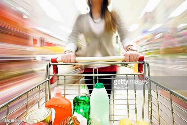 Extreme multicolored motion blur over supermarket shelves as cart passes