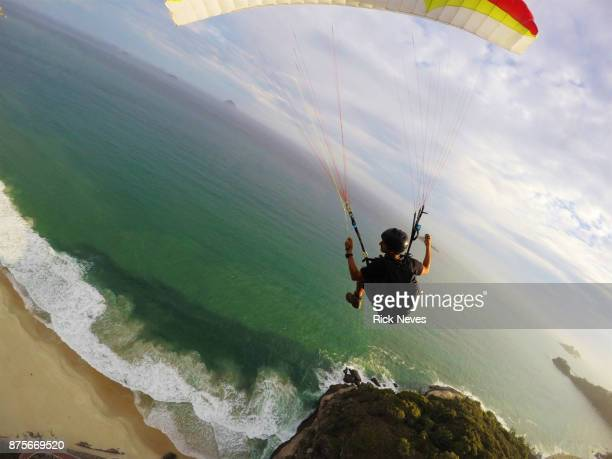 extreme paraglider flying over rio de janeiro - gliding stock pictures, royalty-free photos & images