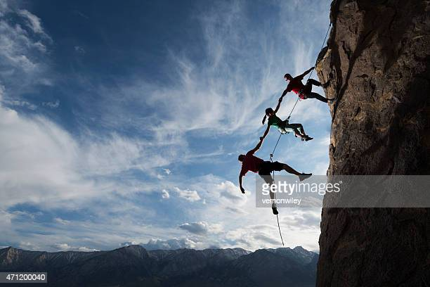 extreme rappelling - three people stock pictures, royalty-free photos & images