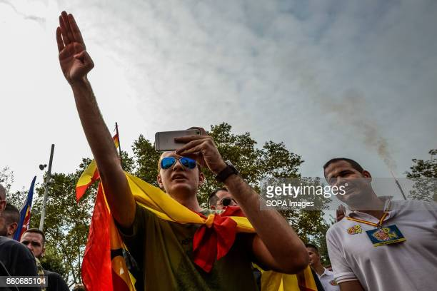 Extreme rightwing demonstrators seen making a nazi salute as they hold an alternative celebration for Spain's National Day A few hundred...