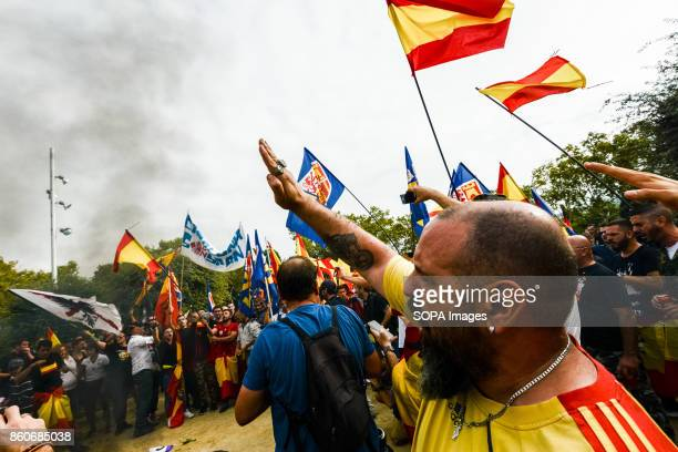 Extreme rightwing demonstrators seen making Nazi salute as they hold an alternative celebration for Spain's National Day A few hundred demonstrators...