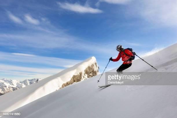 extreme skier in powder snow - watzmann, nationalpark berchtesgaden - alps - skiing stock pictures, royalty-free photos & images