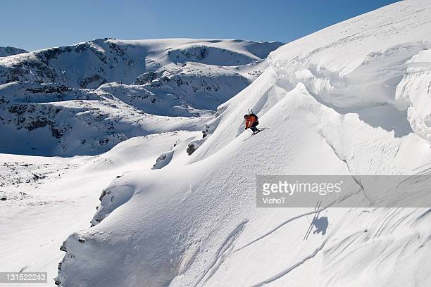 Extreme skier jumping off a cliff