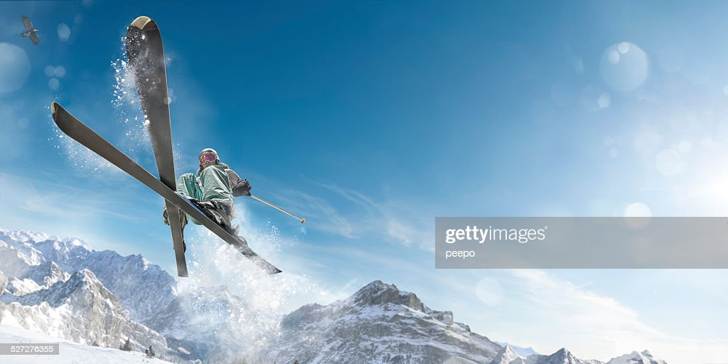 Extreme Skiing Girl in Mid Air Jump Action : Stock Photo