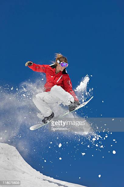 extreme snowboard jump - female skier stock pictures, royalty-free photos & images