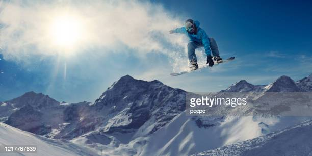 extreme snowboarder in massive big air jump in snowy mountains - vitality stock pictures, royalty-free photos & images