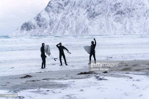 extreme sport surfing on glacier sea - lofoten stock pictures, royalty-free photos & images